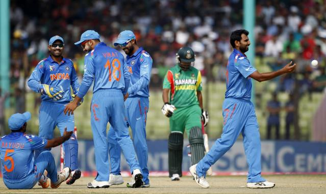 Bangladesh's Shamsur Rahman (2nd R) leaves the field as India's fielders celebrate his dismissal during their Asia Cup 2014 one-day international (ODI) cricket match in Fatullah February 26, 2014. REUTERS/Andrew Biraj (BANGLADESH - Tags: SPORT CRICKET)