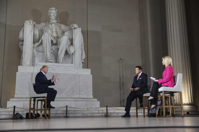 US president Donald Trump speaks to reporters at the Lincoln Memorial in Washington DC on Sunday. (Getty Images)