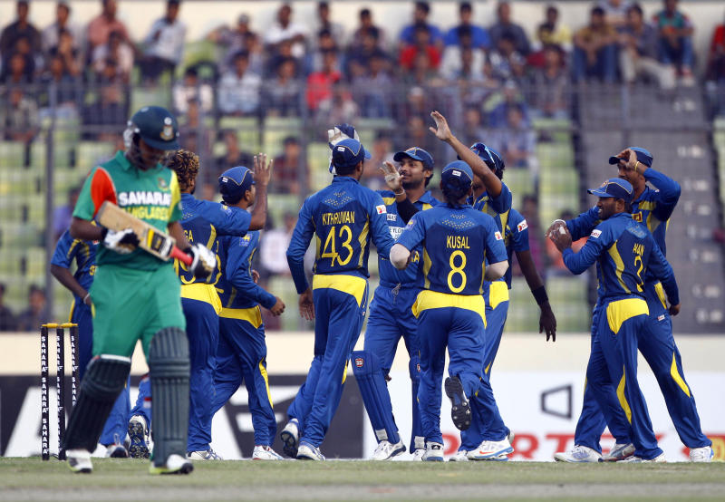 Sri Lankan cricket team celebrates the wicket of Bangladesh's Shamsur Rahman during their second one-day international (ODI) cricket match in Dhaka, Bangladesh, Thursday, Feb. 20, 2014. (AP Photo/A.M. Ahad)