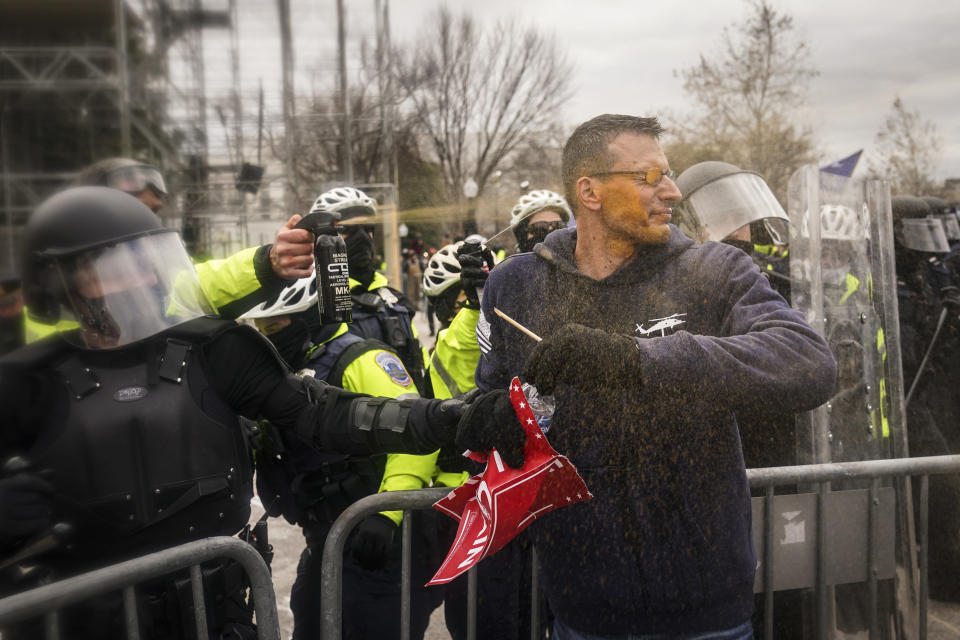 FILE - In this Jan. 6, 2021, file photo, rioters try to break through a police barrier at the Capitol in Washington. (AP Photo/John Minchillo, File)