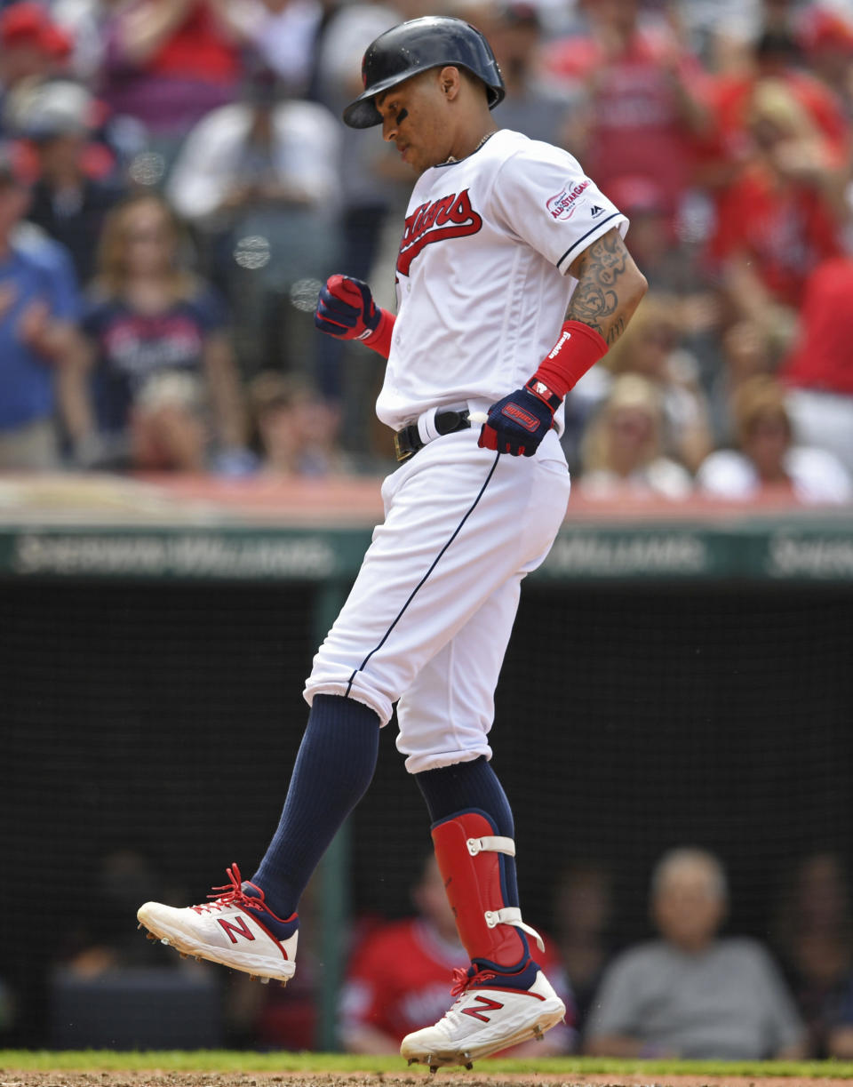 Cleveland Indians' Leonys Martin steps on home plate after hitting a solo home run off New York Yankees relief pitcher Tommy Kahnle in the sixth inning of a baseball game, Sunday, June 9, 2019, in Cleveland. (AP Photo/David Dermer)