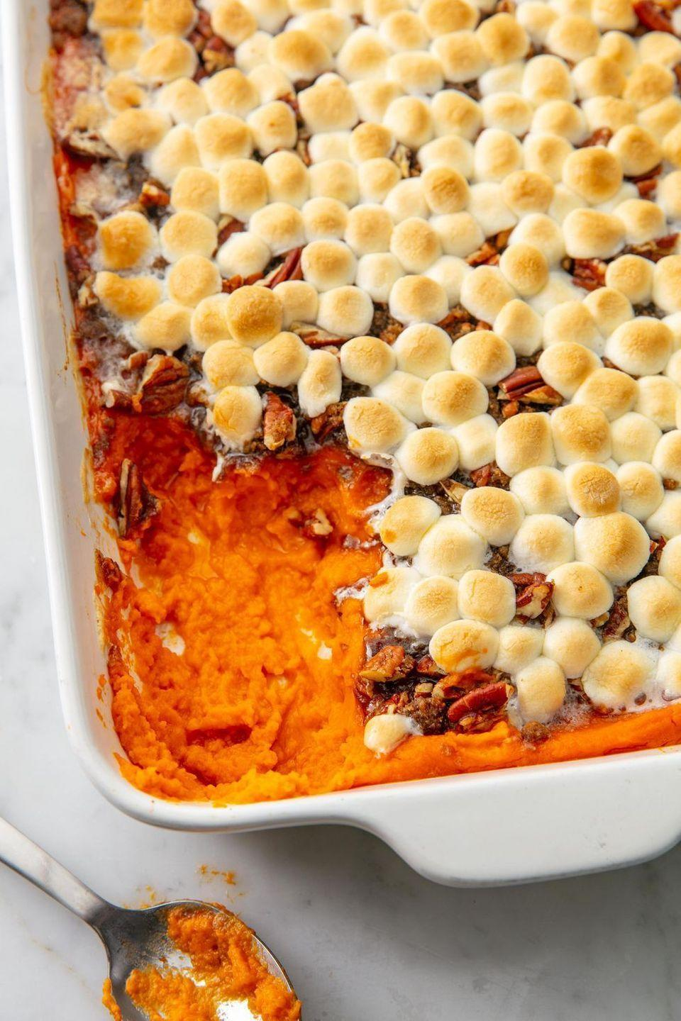 """<p>What is Thanksgiving without sweet potato casserole with mini marshmallows? Just a wasted day, really. Once you try this mini marshmallow recipe, you'll never go back to plain sweet potatoes on Thanksgiving. </p><p><strong><em>Get the recipe at <a href=""""https://www.delish.com/cooking/recipe-ideas/a21960705/best-sweet-potato-casserole-marshmallows-pecans-recipe/"""" rel=""""nofollow noopener"""" target=""""_blank"""" data-ylk=""""slk:Delish"""" class=""""link rapid-noclick-resp"""">Delish</a>. </em></strong></p>"""