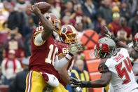 Washington Redskins quarterback Robert Griffin III (10) throws under pressure from Tampa Bay Buccaneers outside linebacker Lavonte David (54) during the first half of an NFL football game in Landover, Md., Sunday, Nov. 16, 2014. (AP Photo/Alex Brandon)