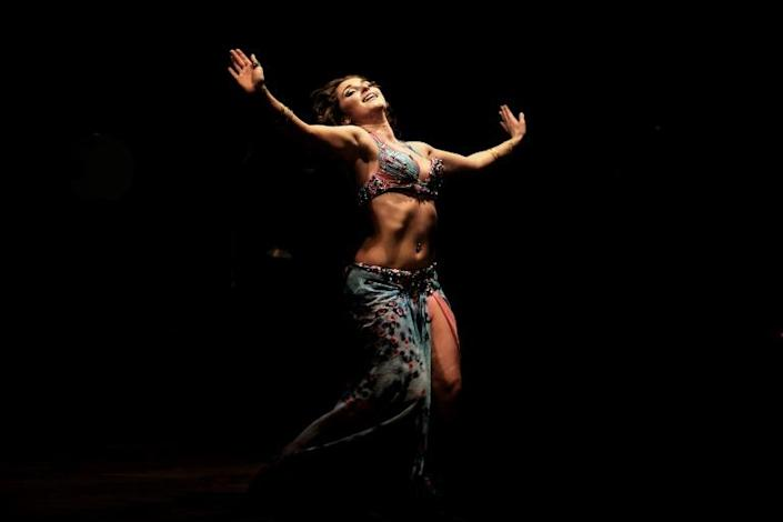 A Russian dancer performs during a belly dancing festival in the Egyptian capital Cairo on December 12, 2012
