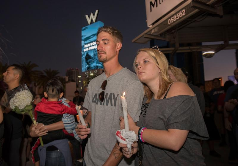 A crowd gathers together for a candlelight vigil held on the north end of the Las Vegas strip.