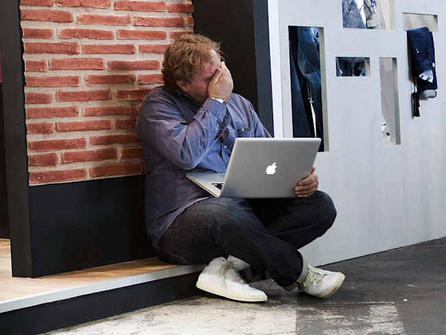 man on laptop frustrated