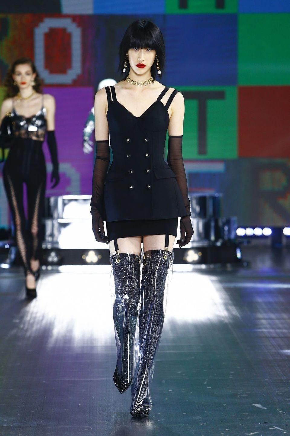 <p>Domenico Dolce and Stefano Gabbana said their Fall 2021 collection would offer a preview of the #DGNEXTCHAPTER. Today they delivered on that futuristic promise with a collection video in which models shared the stage with humanoid robots on loan from Istituto Italiano di Tecnologia, a Genoa research center doing cutting-edge work on human cognition and artificial intelligence. The inspiration may have been clinical, but the collection was pure '90s Dolce & Gabbana fun—think pearl minidresses, metallic moon boots, bejeweled crowns, neon leopard bodysuits and puffer jackets. These are clothes for a post-pandemic disco where we're definitely ready to party but still might want to be wearing PPE. Fortunately, there's a Dolce face shield for that. —<em>Alison S. Cohn</em></p>
