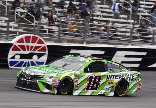 Kyle Busch (18) comes out of Turn 4 during a NASCAR Cup Series auto race in Fort Worth, Texas, Sunday, April 8, 2018. (AP Photo/Larry Papke)