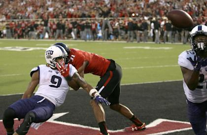 Aaron Green (R) pulls in the game-winning catch for TCU in its win over Texas Tech. (AP)