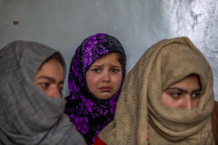 "Tears roll down the cheeks of 7 year old Mahira Nazir, cousin of 16-year-old Athar Mushtaq, as the family talks to Associated Press in Bellow, south of Srinagar, Indian controlled Kashmir, Tuesday, Jan. 5, 2021. On the last week of 2020, Indian government forces killed Athar and two other young men during a controversial gunfight on the outskirts of the Indian-controlled Kashmir's main city. Police did not call them anti-India militants but ""hardcore associates of terrorists."" They later buried them at a graveyard in a remote mountainous tourist resort miles away from their ancestral villages. Athar was the latest Kashmiri to be buried in a far-off graveyard after Indian authorities in a new controversial policy in 2020 started to consign blood-soaked bodies of scores of Kashmiri suspected rebels to unmarked graves, denying the mourning families a proper funeral and a burial. (AP Photo/ Dar Yasin)"