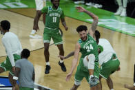 North Texas's Zachary Simmons (24) celebrates with teammates after North Texas defeated Purdue, 78-69, in overtime of a first-round game in the NCAA men's college basketball tournament at Lucas Oil Stadium, Friday, March 19, 2021, in Indianapolis. (AP Photo/Darron Cummings)