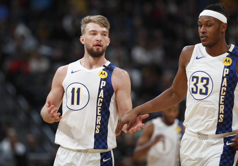 Indiana Pacers center Myles Turner, right, congratulates Indiana Pacers forward Domantas Sabonis after he hit a key basket late in the second half of an NBA basketball game against the Denver Nuggets Sunday, Jan. 19, 2020, in Denver. Indiana won 115-107. (AP Photo/David Zalubowski)