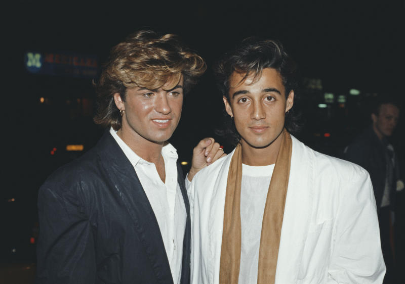 Singers George Michael (left) and Andrew Ridgeley of pop duo Wham!, at the premiere of the film 'Dune', London, England, 1984. (Photo by Fox Photos/Hulton Archive/Getty Images)