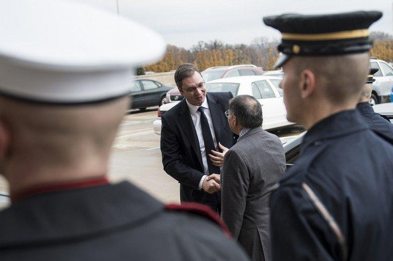 US Secretary of Defense Leon Panetta (C; R) greets Serbia's Minister of Defense Aleksandar Vucic, in Washington, DC
