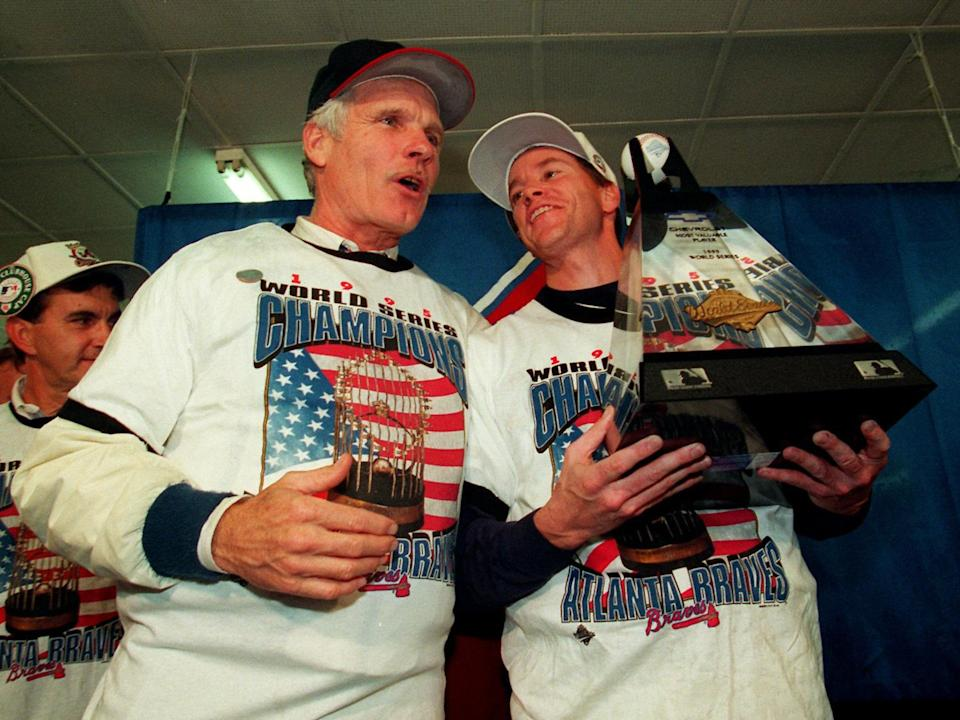 Ted Turner, as Atlanta Braves owner, stands with Tom Glavine, as Atlanta Braves pitcher (l-r), who holds the series MVP trophy after winning World Series, photo