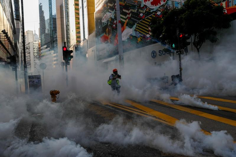 Hong Kong police fire tear gas in feverish start to 22nd weekend of protests in Hong Kong