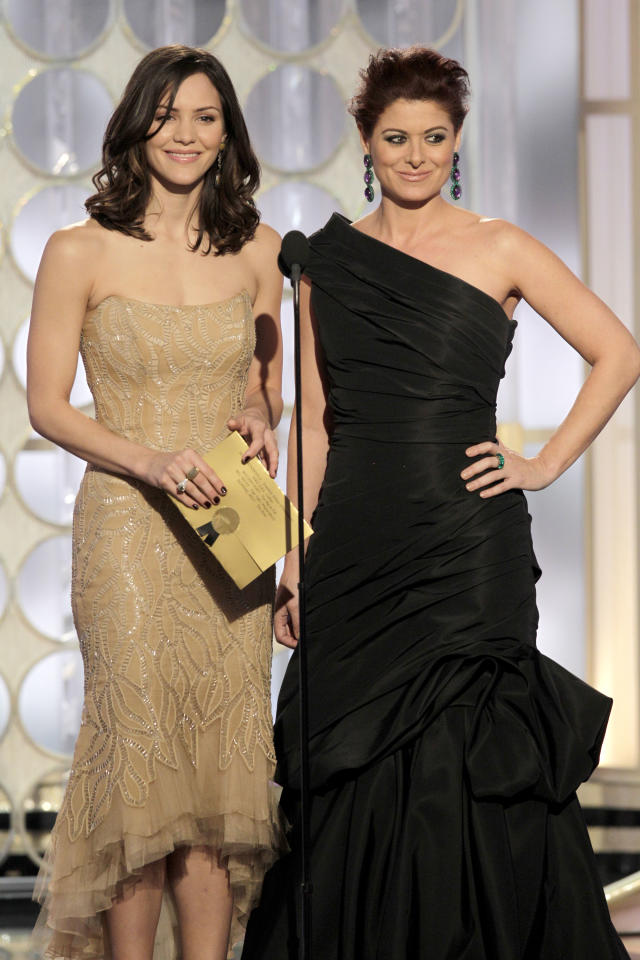 BEVERLY HILLS, CA - JANUARY 15: In this handout photo provided by NBC, actresses Katharine McPhee (L) and Debra Messing present an award onstage during the 69th Annual Golden Globe Awards at the Beverly Hilton International Ballroom on January 15, 2012 in Beverly Hills, California. (Photo by Paul Drinkwater/NBC via Getty Images)