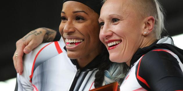 Kaillie Humphries and Phylicia George of Canada celebrate their bronze medal.