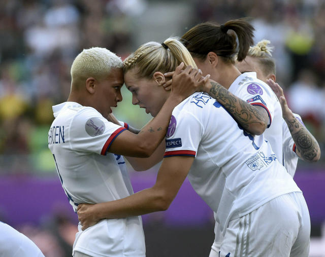 CORRECTS PHOTOGRAPHERS NAME -- Ada Hegerberg of Lyon, front right, celebrates her goal with teammate Shanice van de Sanden, left, during the women's soccer UEFA Champions League final match between Olympique Lyon and FC Barcelona at the Groupama Arena in Budapest, Hungary, Saturday, May 18, 2019. (Balazs Czagany/MTI via AP)