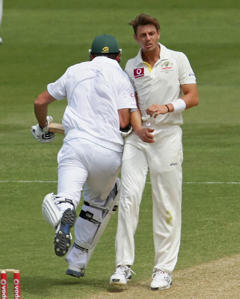 ADELAIDE, AUSTRALIA - NOVEMBER 23:  Graeme Smith of South Africa bumps into James Pattinson of Australia as he runs between the wickets during day two of the Second Test match between Australia and South Africa at Adelaide Oval on November 23, 2012 in Adelaide, Australia.  (Photo by Scott Barbour/Getty Images)