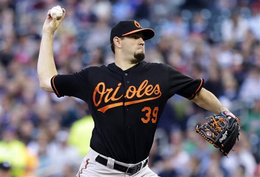 Baltimore Orioles pitcher Jason Hammel throws against the Minnesota Twins in the first inning of a baseball game on Friday, May 10, 2013, in Minneapolis. (AP Photo/Jim Mone)