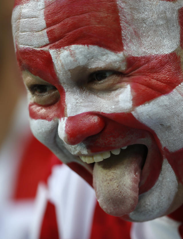 Fan sticks his tongue out prior to the start of the semifinal match between Croatia and England at the 2018 soccer World Cup in the Luzhniki Stadium in Moscow, Russia, Wednesday, July 11, 2018. (AP Photo/Francisco Seco)