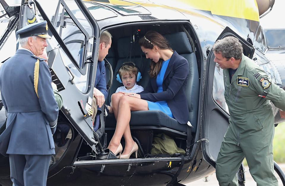 FAIRFORD, WALES - JULY 08:  Catherine, Duchess of Cambridge, Prince William, Duke of Cambridge and Prince George sit in a Squirrel helicopter during a visit to the Royal International Air Tattoo at RAF Fairford on July 8, 2016 in Fairford, England.  (Photo by Chris Jackson/Getty Images)