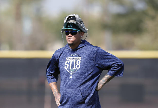 FILE - In this Feb. 19, 2018, file photo, Seattle Mariners starting pitcher Felix Hernandez watches a drill during a baseball spring training workout, in Peoria, Ariz. So far the story of spring training for the Mariners is the growing list of injuries. The latest is Felix Hernandez who took a liner off his right arm and now may see his Catcus League plans altered. (AP Photo/Charlie Neibergall, File)