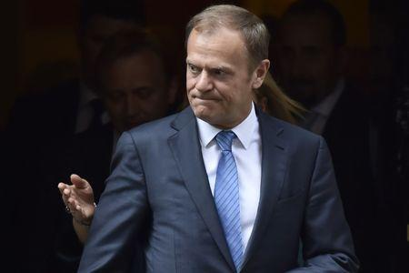 Tense crowd meets Tusk who testifies in Polish investigation