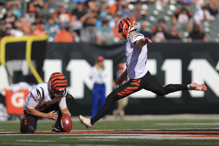 Cincinnati Bengals kicker Evan McPherson (2) kicks a field goal from the hold of Kevin Huber in the first half of an NFL exhibition football game against the Miami Dolphins in Cincinnati, Sunday, Aug. 29, 2021. (AP Photo/Aaron Doster)