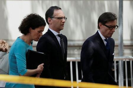 Germany's Foreign Minister Heiko Maas leaves the West Wing with aides after meeting with U.S. National Security Advisor John Bolton at the White House in Washington, U.S., May 23, 2018. REUTERS/Carlos Barria