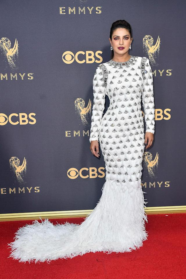 <p>Chopra looked absolutely stunning in a white Balmain gown, complete with crystal details and a full feather skirt. (Photo: Getty Images) </p>