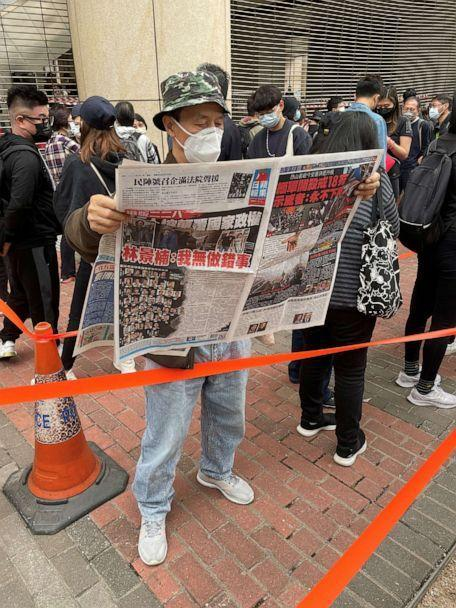 PHOTO: A supporter reads local paper Apple Daily, which has become a marker of the democracy movement. (ABC News)