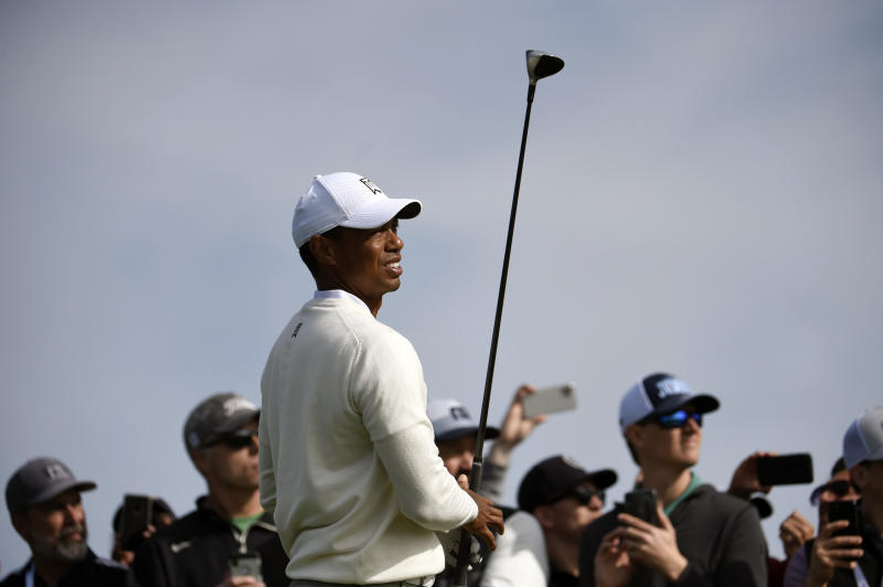Tiger Woods watches his tee shot on the second hole of the South Course at Torrey Pines Golf Course during the second round of the Farmers Insurance golf tournament Friday Jan. 24, 2020, in San Diego. (AP Photo/Denis Poroy)