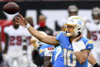 Los Angeles Chargers quarterback Justin Herbert (10) fires a pass against the Tampa Bay Buccaneers during the first half of an NFL football game Sunday, Oct. 4, 2020, in Tampa, Fla. (AP Photo/Jason Behnken)