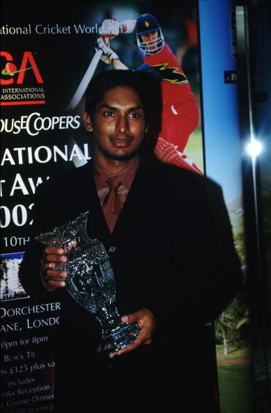 LONDON - JULY 10th :  Kumar Sangakkara poses with his award during the FICA International Cricket Awards held at the Dorchester Hotel, London on the 10th July 2002.(Photo By Bryn Lennon/Getty Images)