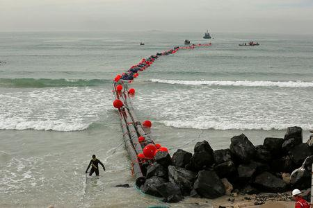 Intake pipes for the Strandfontein temporary desalination plant are pulled ashore near Cape Town, South Africa, February 6, 2018. REUTERS/Mike Hutchings