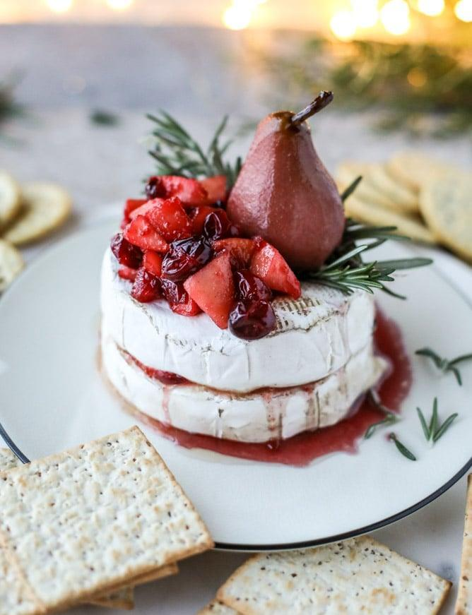 """<p>Imagine: two layers of creamy cheese; caramelized apples, pears, and cranberries; and a dash of butter, sugar, and cinnamon. Now tell us, what could possibly be better?</p> <p><strong>Get the recipe:</strong> <a href=""""https://www.howsweeteats.com/2016/12/caramelized-winter-fruit-stuffed-brie-cheese-pinot-poached-pear/"""" class=""""link rapid-noclick-resp"""" rel=""""nofollow noopener"""" target=""""_blank"""" data-ylk=""""slk:caramelized winter-fruit-stuffed brie"""">caramelized winter-fruit-stuffed brie</a></p>"""