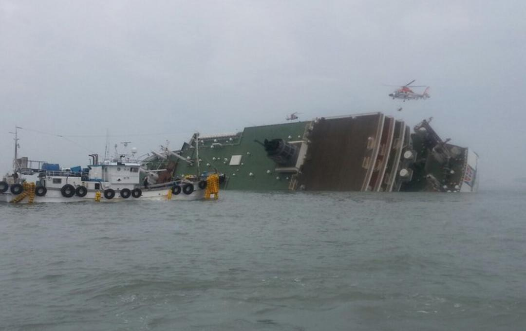 South Korea rescue helicopter and fishing boats try to rescue passengers from a passenger ship in water off the southern coast in South Korea, Wednesday, April 16, 2014. The South Korean passenger ship carrying more than 470 people, including many high school students, is sinking off the country's southern coast Wednesday after sending a distress call, officials said. There are no immediate reports of causalities. (AP Photo/Yonhap) KOREA OUT