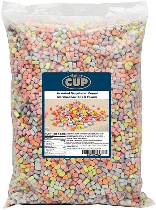 """<h2>By The Cup Assorted Dehydrated Cereal Marshmallow Bits<br></h2><br><strong>What is it? </strong>A three-pound bag of the """"marshmallow"""" pieces from youthful cereals like Lucky Charms<br><br><strong>What's the hottest take? </strong>While a grain-free bowl of """"just the marshmallows"""" is a childhood dream come true for many cereal-lovers, some reviewers found that the fantasy quickly went south. Erin Nissey writes: """"While the product arrived in good shape, on time and as expected, I really wasn't clear on how much 3 POUNDS of dehydrated marshmallows would actually be. Unless you are Lucky the Leprechaun and the factory that made those delicious bits of sugary heaven closed down for good, there is no reason that anyone should ever, ever need this many cereal marshmallows. There are literally (not actually literally) a million marshmallows in this bag. Every time I look at it, I start laughing. But not a cheerful, mirthful laugh. More like a wild, panicky laugh as I contemplate how I'll ever finish this bag of marshmallows. I may end up willing these to my grandchildren, which means I need to get busy finding a husband because I'm 37 years old and don't even have a children yet. It's TOO MUCH PRESSURE! Really, seriously, if you're drunkenly surfing Amazon at 3 AM and think, 'I've always wanted a box of Lucky Charms but none of the yucky oat bits' — reconsider. Turn back. Maybe start with the pound bag and see how that works for you. Don't make the mistake I made.""""<br><br> <br><br><strong>By The Cup</strong> Assorted Dehydrated Cereal Marshmallow Bits, $, available at <a href=""""https://amzn.to/3qiDP8X"""" rel=""""nofollow noopener"""" target=""""_blank"""" data-ylk=""""slk:Amazon"""" class=""""link rapid-noclick-resp"""">Amazon</a>"""