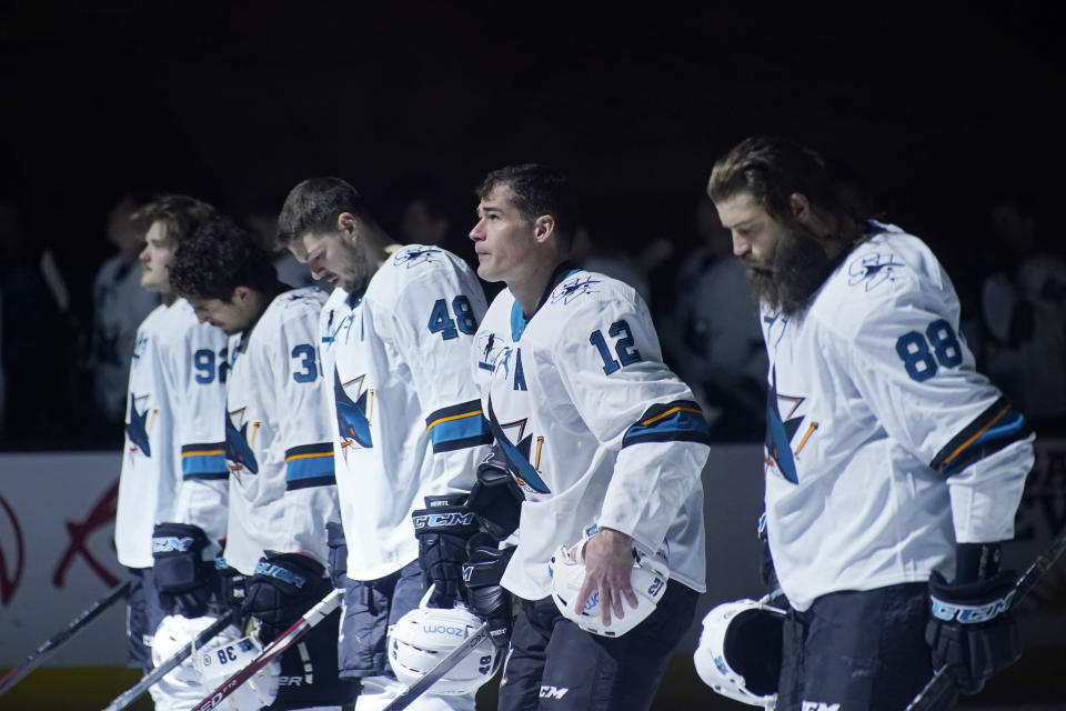 San Jose Sharks center Patrick Marleau (12) stands on the ice during the national anthem before the first period of an NHL hockey game Monday, April 19, 2021, in Las Vegas. (AP Photo/John Locher)