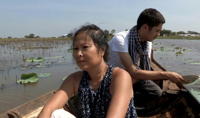 """Documentary subject Eng Suon and her filmmaker son Guillaume Suon aboard a boat on their return to Cambodia during the shooting of """"The Taste of Secrets"""", which is in competition at the Busan International Film Festival in South Korea (AFP Photo/Handout)"""