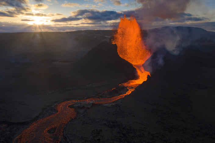 Lava flows from an eruption of the Fagradalsfjall volcano on the Reykjanes Peninsula in southwestern Iceland on Tuesday, May 11, 2021. (AP Photo/Miguel Morenatti)