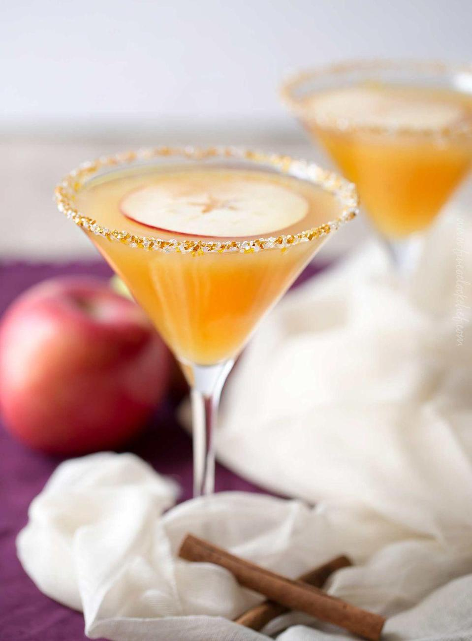 """<p>How gorgeous is this caramel apple martini? The glass is rimmed with caramel sauce and edible glitter!</p><p><strong>Get the recipe at <a href=""""https://www.thechunkychef.com/spiced-caramel-apple-martini/"""" rel=""""nofollow noopener"""" target=""""_blank"""" data-ylk=""""slk:The Chunky Chef"""" class=""""link rapid-noclick-resp"""">The Chunky Chef</a>.</strong></p><p><a class=""""link rapid-noclick-resp"""" href=""""https://go.redirectingat.com?id=74968X1596630&url=https%3A%2F%2Fwww.walmart.com%2Fsearch%2F%3Fquery%3Dmartini%2Bglasses&sref=https%3A%2F%2Fwww.thepioneerwoman.com%2Ffood-cooking%2Fmeals-menus%2Fg33510531%2Ffall-cocktail-recipes%2F"""" rel=""""nofollow noopener"""" target=""""_blank"""" data-ylk=""""slk:SHOP MARTINI GLASSES"""">SHOP MARTINI GLASSES</a> </p>"""
