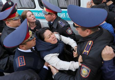 Police officers detain anti-government protesters during a rally in Almaty, Kazakhstan March 22, 2019. REUTERS/Pavel Mikheyev