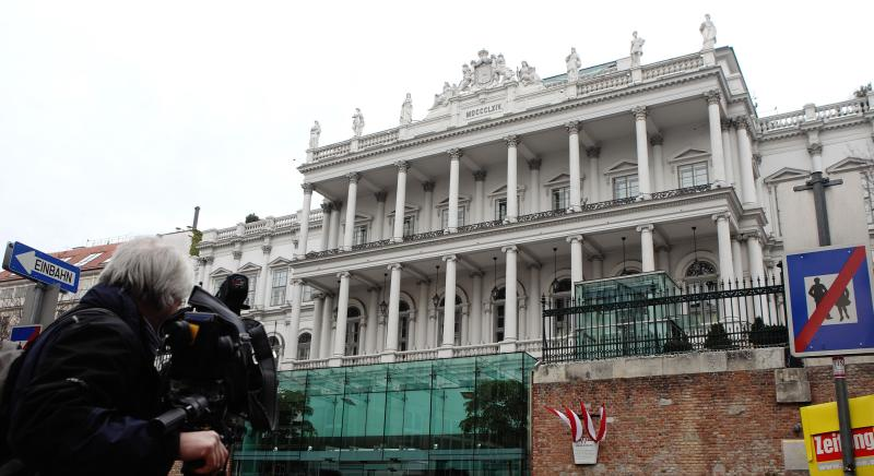 A cameraman films outside Palais Coburg hotel where nuclear talks are taking place in Vienna