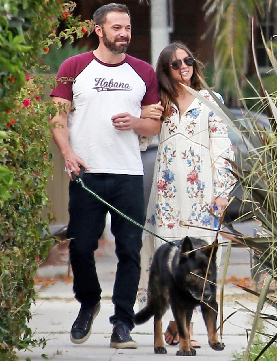 <p>Ben Affleck and girlfriend Ana de Armas walk their dogs arm-in-arm on Tuesday in L.A.</p>