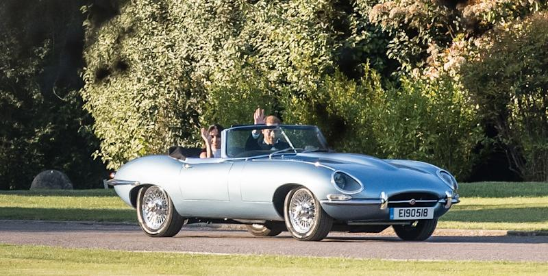 this vintage jaguar is the royal wedding car