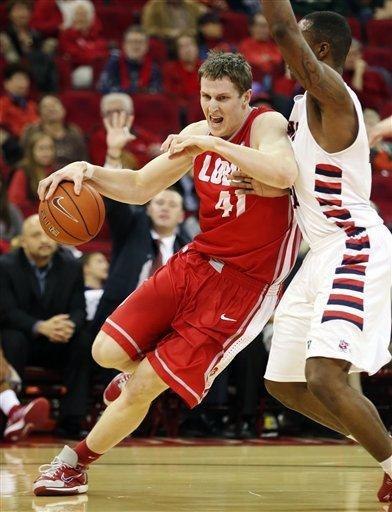 New Mexico's Cameron Bairstow, left, drives around Fresno State's Kevin Foster in the first half of an NCAA college basketball game in Fresno, Calif., Wednesday, Feb. 13, 2013. (AP Photo/Gary Kazanjian)