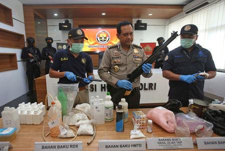 Indonesian police show items seized, including weapons and bomb-making materials, that they say were intended for use to attack government buildings and the Myanmar embassy, at police headquarters in Jakarta